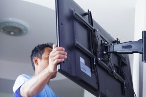 consider using space saving TV wall brackets to mount your tv or monitor